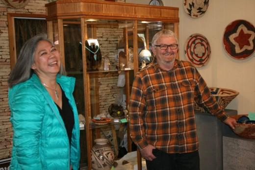 Janet and Larry Everitt are seen here at their studio and gallery in Idyllwild. The Everitts mine, cut, polish and set their own semi-precious stones, designing and fabricating striking and luminous jewelry pieces. Photo by Marshall Smith