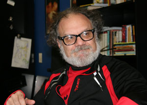 Artist of the week J. Barrett Cooper, chair of the Theatre Department at Idyllwild Arts Academy, in his office explaining the paramount importance of the playwright's words in staging and interpreting a play. Photo by Marshall Smith