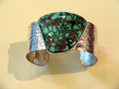Shown here is a piece of Godber green turquoise from the Everitts' mine in Austin, Nevada. It has been cut, polished and set in a sterling silver bracelet by Larry Everitt. Both Larry and Janet Everitt are skilled lapidaries and silversmiths. Photo courtesy of the Everitts.
