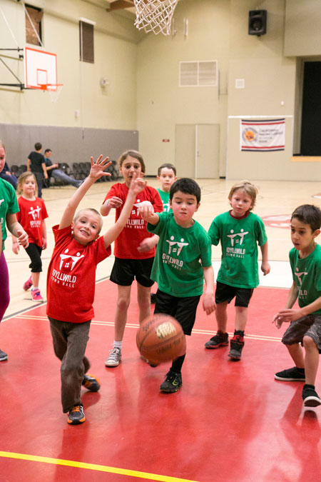 The Trojans (in red) and the Wild Cats (in green) played each other during youth basketball at Idyllwild School Tuesday night, Jan. 19. Read the sports report on page 14.Photo by Jenny Kirchner