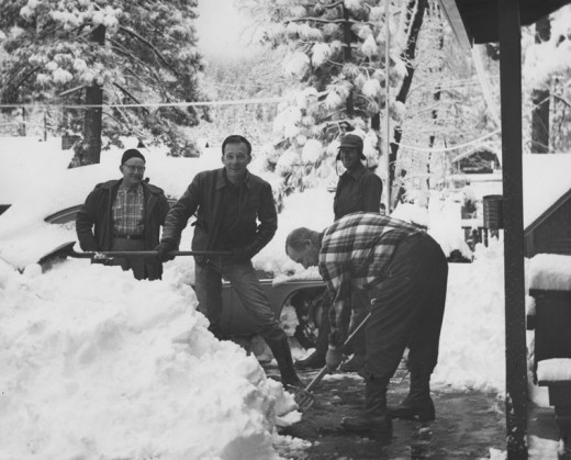 Law officers and firefighters swung shovels at the Idyllwild Fire Station in the heavy snow winter of January 1960. From left, are Brady Baker and Jim Henry of the sheriff's department, and Dwight Metcalfe and Larry Shinn (in back) of the fire department. File photo