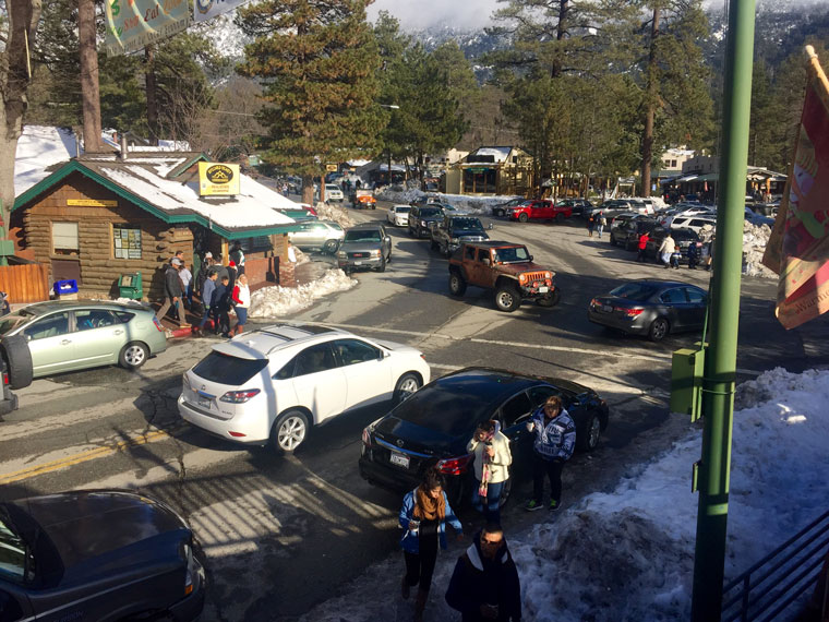 Last week's snowstorm attracted thousands of visitors to Idyllwild over the weekend. Here, the center of town is jammed with traffic and parked cars. Photo at left by Jenny Kirchner