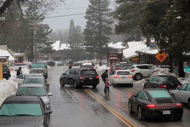 Even the rain Saturday morning did not deter visitors wanting to attend the Idyllwild International Festival of Cinema and play in the snow. Photo Above by John Drake