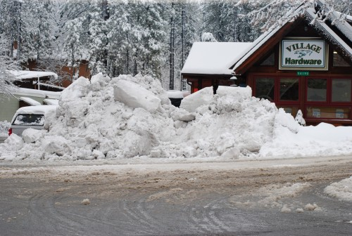 One of the biggest snow piles is in front of Village Hardware.