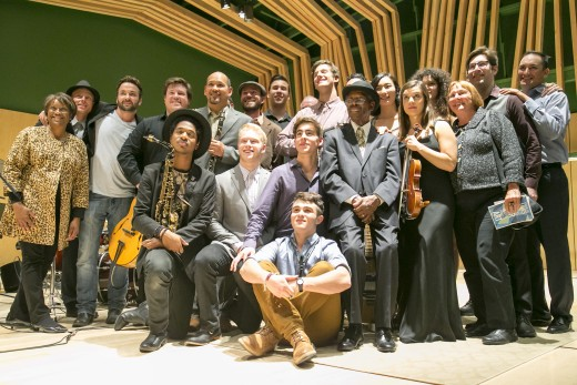 Alumni and current students pose with Marshall Hawkins after the jazz performance Saturday night at the Lowman Concert Hall. Photo by Jenny Kirchner