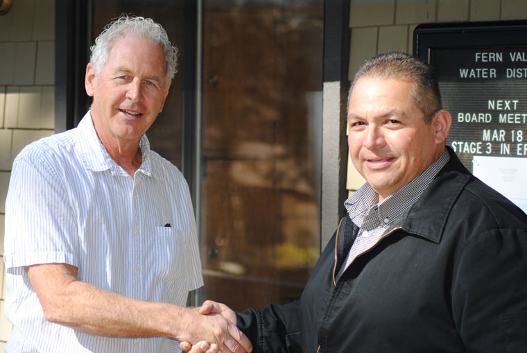 Fern Valley Water District Board President Jim Rees (left) congratulates Victor Jimenez after the board selected him as the next FVWD general manager. Photo by JP Crumrine