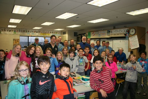 """Right, Idyllwild Rotary presented headsets to be used with Chromebooks the school had previously acquired on Monday, March 14 in fourth grade teacher Tom Dillon's classroom. Rotary presented 289 of the headsets in appreciation for Principal Matt Kraemer and the school coming to the rescue of the Harvest Festival when, due to the unexpected closing of Town Hall for asbestos reasons, the Harvest Festival was homeless. Kraemer worked quickly with Rotary and school staff to stage the festival in the Idyllwild School gymnasium. The 2015 Harvest Festival, as a result of the additional space, turned out to be one of the most successful ever. Said Rotary President Chuck Weisbart, """"There is never 'too much' that our Rotary Club can do for our community!"""" Photo by Marshall Smith"""