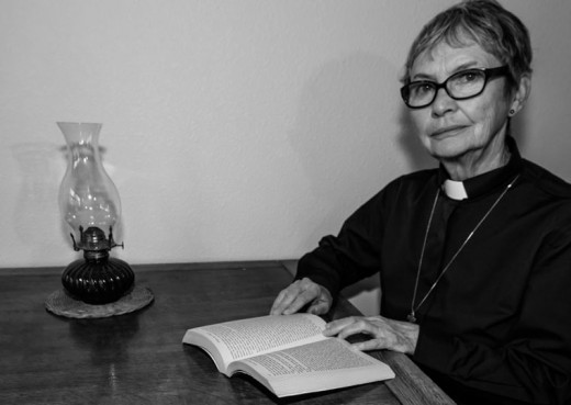 """Michèle Marsh stars as Hannah, an Episcopal priest, struggling with issues of family and faith in the Idyllwild Actors Theatre production of Keith Bunin's play """"The Busy World is Hushed.""""Photo by Peter Szabadi"""