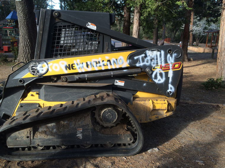 "Vandals wrote ""Stop hurting Idyllwild"" on Pacific Slope Tree Company's equipment, which was at the Idyllwild Community Center site in order to bring down many dead pine trees. Photo courtesy Josh Whitney"