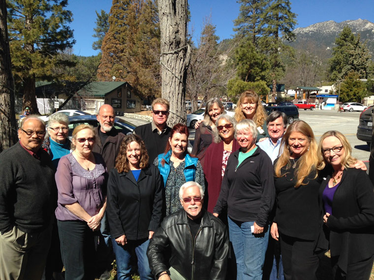 The Idyllwild Community Fund Advisory Committee posed for a collective photograph after a welcome luncheon at the Gastrognome Restaurant for five new members last week. Kneeling in front is Marshall Smith (president). Second row (from left) are Jose Marquez (Community Foundation director of Philanthropic Services), Shannon Houlihan Ng, Jayne Davis (corresponding secretary), Callie Wight, Lenore Sazer, Holly Guntermann (youth grantmakers coordinator), Bill Sperling, Jeri-Sue Haney (recording secretary and vice president for strategic planning) and Suzanne Avalon (vice president for events). Back row (from left) are Mary Morse (vice president for social media), Lou Bacher, Chris Scott, Larrynn Carver (treasurer and vice president for marketing) and Kathy Harmon-Luber (vice president for fundraising). Not present for the photograph is Jim Nutter (vice president). Photo courtesy Suzanne Avalon