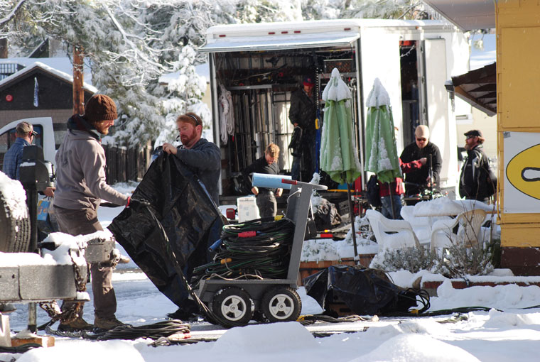 A movie crew films Tuesday morning at the Town Baker. On Monday, they were at the Idyllwild Library. Photo by JP Crumrine