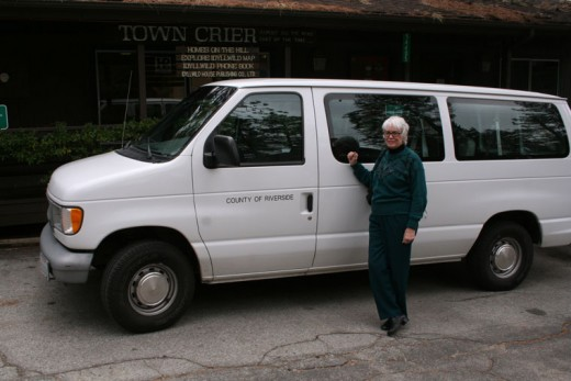 Reba Coulter shows off the newest addition to the fleet of Forest Folk's Idyllwild Shuttle. The van was donated by Riverside County.Photo by Jack Clark