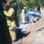 Three overturned  vehicles, one  two-car collision