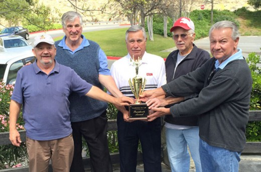 Grandfathers For Golf held its first Volunteers Tournament on Tuesday, March 29, at the Golden Era Golf Course in San Jacinto. Winners of the four-man scramble format were (from left) Idyllwilder Jim Crandall (Grandfathers board secretary), former Idyllwilder Tony Viola (vice president), and volunteers Bob Wadlow and Gene Slocum. President Ernie Kercmar (far right) presented the Presidents Trophy, which will be inscribed with the golfers' names. The foursome shot a 16-under-par 56 that included 3 pars, 14 birdies and an eagle on the last hole. Grandfathers For Golf is a nonprofit organization based in San Jacinto dedicated to teaching at-risk kids and others the game of golf. Participating children are given a set of golf clubs, a hat and shirt, and six weeks of instruction at three area golf courses. Photo by David Hiemenz
