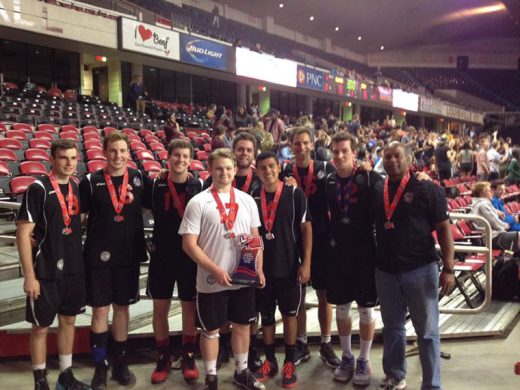 Pine Cove resident Aric Anderson (far right), coach for the Chapman University Panthers, with his team after their silver-medal volleyball win. Photo courtesy Aric Anderson