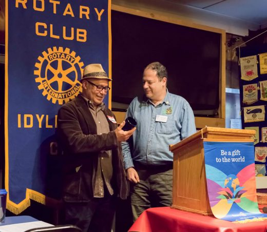 Well-known Idyllwild author and teacher Eduardo Santiago (left) received an official Rotary coffee mug from Idyllwild Rotary President Mark Kassouf (right) as thanks for speaking at the Rotary's weekly meeting on April 20. Most of Santiago's remarks related to his recent visit to Cuba, his native land, and his insights were particularly interesting in light of the recent changes in the relationship between Cuba and the United States. Photo by Tom Kluzak