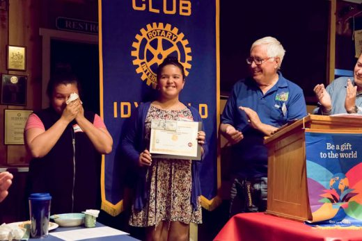 Jessica Ruelas (center) was honored with the sixth-grade Idyllwild Rotary Citizenship Award and Scholarship at the Rotary meeting on April 20. Jessica's teacher at Idyllwild School praised her as being conscientious and always willing to help others. She tutors other students and plays the cello in the school band. Presenting the award is Rotarian Scott Fisher (right). Jessica's mother, Maura (left), is obviously proud of her daughter's accomplishments.Photo by Tom Kluzak