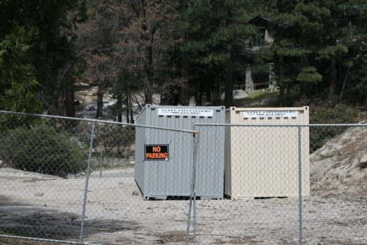 Two large metal storage containers in Fern Valley Corners have opened a Code Enforcement case and investigation. The containers, part of the business operations of Idyllwild Property Management, are allegedly in violation of county code. Photo by Marshall Smith