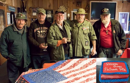 From left, Gary Button, Russell Frederick, Dave Fraser, Ron Draper and Tom Visel were among the many Vietnam veterans honored at the Welcome Home remembrance held at American Legion Post 800 on March 30. This annual event commemorates the date that all combat troops returned home from Vietnam. The Mountain Quilters of Idyllwild donated quilts that were raffled at the event and the Idyllwild Bake Shop and Brew provided the cake. Photo by Tom Kluzak
