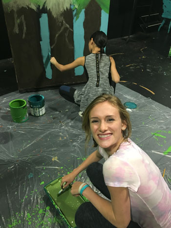 """Cari Quigley, Idyllwild Arts theater major, takes a break from set painting for the Idyllwild School musical """"Alice in Wonderland.""""Photo courtesy Miguel Soto"""