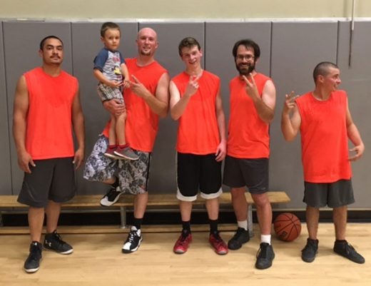 Second-place winners of Town Hall Adult Basketball are, from left, Sean Davis, Buddy Beagle (holding son Landon Beagle), Ben Goulding, Brian Ensman and Roman Parillo. Photo courtesy Bob Lewis