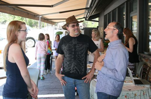 Holistic health practitioner Steven Morrison (right) mixed with interested attendees, including Julian Geisinger (center) at Sky Island Organic's first Health Fair, held on Saturday, May 14. Photo by Marshall Smith