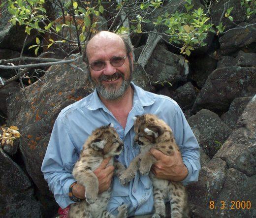 Dr. John Laundré with two mountain lion cubs. Photo courtesy Dr. John Laundré