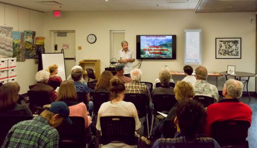 Joe Miglore, a very knowledgeable amateur geologist and hardworking volunteer with the Friends of the Desert Mountains, explains the geology of the San Jacinto Mountains to a packed conference room at the Idyllwild Library on May 18. Sponsored by the Friends of the Idyllwild Library, his fascinating presentation described the origins of our mountains from the interactions of tectonic plates hundreds of millions of years ago to the time when this land was part of a super-continent. Photo by Tom Kluzak