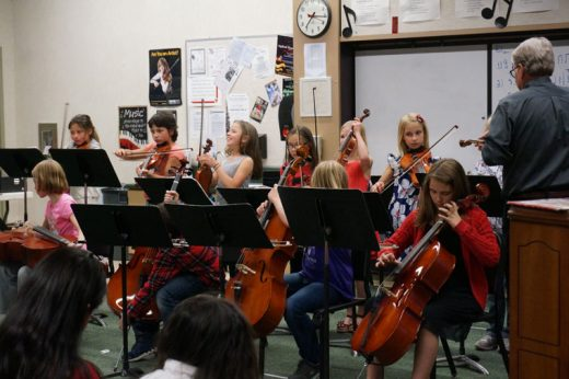 """After the Idyllwild School Open House, Thursday, May 5, the school orchestra performed in the Music Room. Dwight """"Buzz"""" Holmes (far right) directed the young musicians.Photo by Chandra Lynn"""