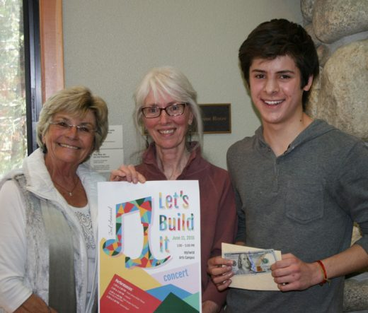 """Idyllwild Arts visual arts student Cristobal Ayala Roche won the """"Build It"""" poster contest commissioned by the Idyllwild Community Center. He is seen here with ICC representatives Suzon Capparelli (left) and Trish Tuley. Twenty five IA students in Melissa Wilson's graphic design course competed in the contest. Posters are on display in the campus dining hall lobby.Photo by Marshall Smith"""