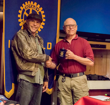 Idyllwild author and speaker Rick Barker receives a Rotary mug from Idyllwild Rotary President Chuck Weisbart at the April 27 Rotary meeting. Barker presented some interesting facts and musings about human perception and awareness that were well-received and followed by insightful answers to questions from the audience.       Photo by Tom Kluzak