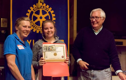 Emily Hill (center), accompanied by her mother Angie (left), received the Idyllwild Rotary Eighth-grade Citizenship Award and Scholarship from Scott Fisher (right) at the May 11 meeting of the Idyllwild Rotary Club. Emily's teacher, Christy Tilley, described her amazing leap in maturity, responsibility and desire to succeed over her three years at Idyllwild School.       Photo by Tom Kluzak