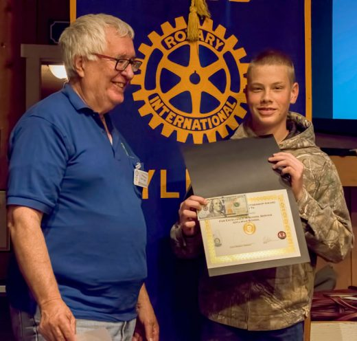Idyllwild School student Nick Davis (right) receives the Rotary eighth-grade Citizenship Award and Scholarship from Rotarian Scott Fisher at the Idyllwild Rotary Club's May 4 meeting. Nick was accompanied by brother Levi, mother Myla and father Chris. His teacher, Donna Mercer, praised Nick as responsible and helpful in class, and mentioned that he is looking forward to college. Photo by Tom Kluzak
