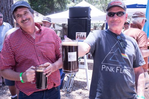 At Saturday's Second Paws for Rhythm and Brews, Chris Austin holds his full stein of beer. Austin repeated as the men's champion beer stein holder. Jim Adams of Forest Lumber sponsors the event. Photos by Peter Szabadi