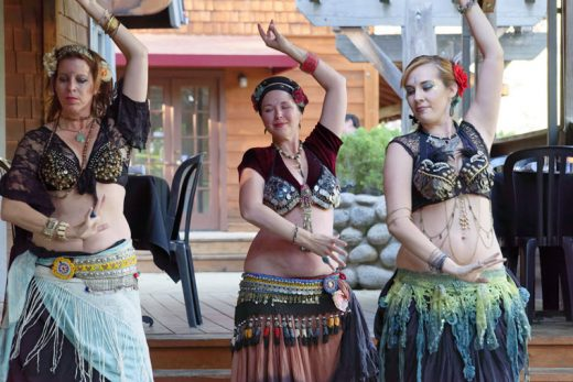 The Manzanita Moon Belly Dancers added some spice to Café Aroma dinners on Friday, June 17. Patrons enjoyed the fine dancing and elaborate costumes of (from left) Christina Nordella, Rachel Welch and Jessie Estrada. Photo by Tom Kluzak