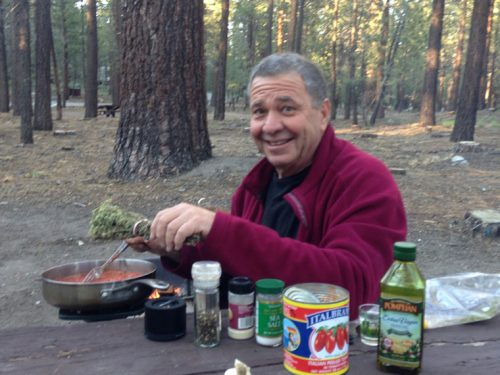Food columnist Vic Sirkin enjoys preparing a meal while camping in Northern California. Photo by Kate Sirkin