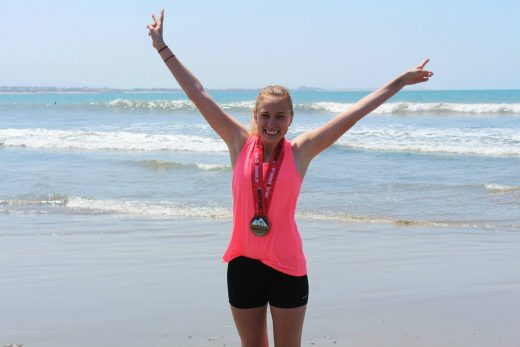 Michele Bryant, new Pine Cove resident, will run in the San Diego Rock 'n' Roll Marathon on Sunday, June 5. Bryant is running a half-marathon to raise money for St. Jude Children's Hospital. She is seen here on the beach after running a previous marathon. Photo courtesy of Michele Bryant