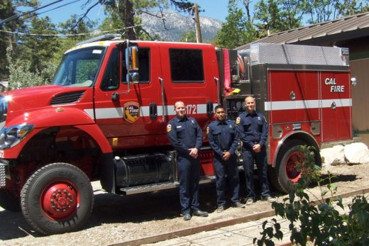Standing in front of the new state engine, which is hosted at Station 23 are (from left) Capt. Josh Lent, firefighter Martin Menez, and firefighter Ryan Ortiz. Photo by Jeremy Potter