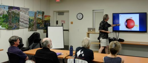 Town Crier photographer Tom Kluzak discusses color management, printing and photographic software with members of the Idyllwild Photographers at the Idyllwild Library on June 22. The group, which meets on the fourth Wednesday of every month at 5 p.m., is open to anyone with an interest in photography. Photo by Tom Kluzak