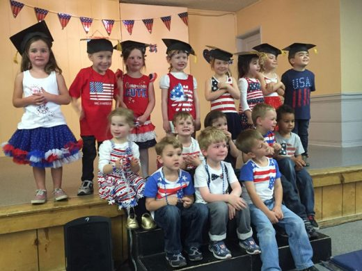May 15 was The Lil Critters Preschool's 20th Annual Graduation Show. The 2016 graduating class posed for one more photo. Kathy Lewis and Heather Solorio are the school's teachers.  Photo by Teresa Teel