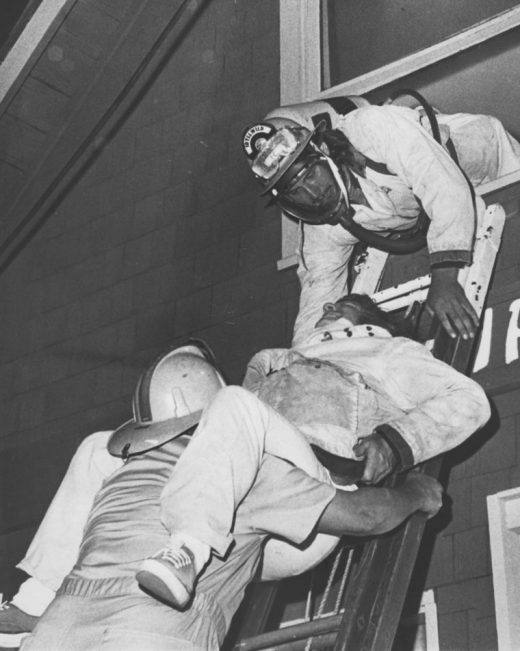 It looked real, but Keith Smith (top), Joe Picchiottino and George Martinak (bottom) were only practicing for Idyllwild Fire Department, the correct way to ease an injured person down a ladder in June 1974.File photo