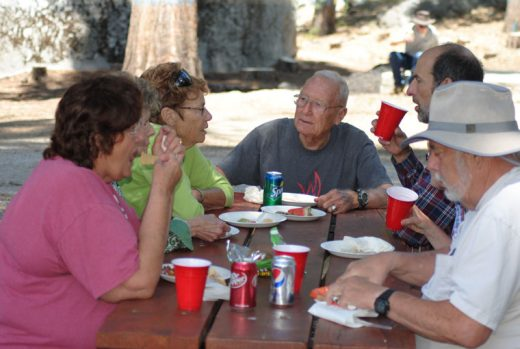 Former Pine Cove Water District President Barney Brause, center, was one of several hundred customers enjoying the food at Saturday's PCWD Customer Appreciation Day. Photo by J.P. Crumrine