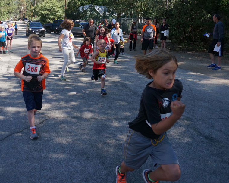 The Half Mile Kids' Race was just as competitive as the 5K and10K runs. Photo by  Chandra Lynn