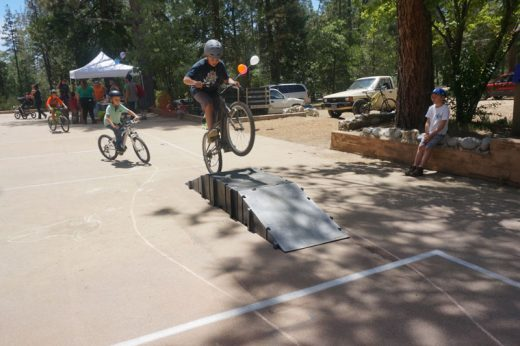 The Idyllwild Library Bike Rodeo was Sunday at the ICC site. Here several riders perform bike tricks. Photo by Chandra Lynn