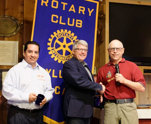 Kurt Burton (left), major gifts officer, and Gene Coughlin (center), regional director of Service to the Armed Forces, Desert to the Sea Region, of the American Red Cross, receive Rotary mugs from Idyllwild Rotary President Chuck Weisbart at the June 8 weekly meeting of the Rotary Club. Coughlin spoke at the meeting about the Hero Care Network, a pilot project of the Red Cross designed to assist veterans utilizing Red Cross resources previously available only to active-duty service members. Photo by Tom Kluzak