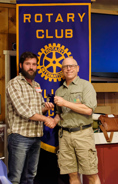 After Dominick Surina (left) gave a presentation on geocaching at the Idyllwild Rotary Club June 1 meeting, he received a commemorative mug from Rotary President Chuck Weisbart. As Surina explained to the Rotary members, most of whom had never heard of geocaching, it is a world-wide GPS-guided scavenger hunt that brings people of all ages together to experience the great outdoors.     Photo by Tom Kluzak
