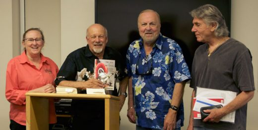 "Ron Singerton with his historical novel ""The Silk and the Sword"" is flanked by Librarian Shannon Ng (left), Bill Barnett and Ken Luber last Saturday during his talk at the Idyllwild Library. Photo by John Drake"