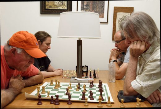 Members of the Idyllwild Chess Club concert on their games at their weekly Friday afternoon meeting at the Idyllwild Library. Attending on July 22 are, from left, Dick Goldberg, Simone Sobel, Krister Raith and DF Tweedie. Players of any skill level, even experts, can expect a friendly but challenging experience, since Sobel is ranked among the best women players in the world. Photo by Tom Kluzak