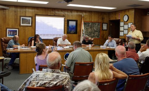 About 25 people showed up for the Idyllwild Water District board meeting Wednesday night, July 20. Some challenged the board on rates, water meters and transparency. Vic Sirkin (standing, right) gave a prepared speech critical of directors and the manager, and calling for directors' resignations. Excerpts from the meeting may be viewed at idyllwild towncrier.com. Photo by Tom Kluzak