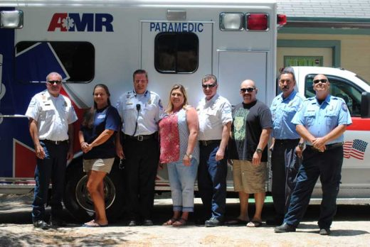 On its one-year anniversary, the American Medical Response crews had a  barbecue to celebrate their service to Pine Cove. Here (from left) are Jack  Hansen, AMR's operations manager; Kim Brown, EMT; James Palmer, supervisor;  Anita Flaa, administrative assistant; Rod Parr, supervisor; Sebastian Vargas, EMT; Richard Alvarado, paramedic; and Pat Price, paramedic. Photo by JP Crumrine